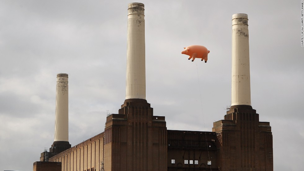 An inflatable pig flies over the station 35 years later, recreating the famous album cover on September 26, 2011.