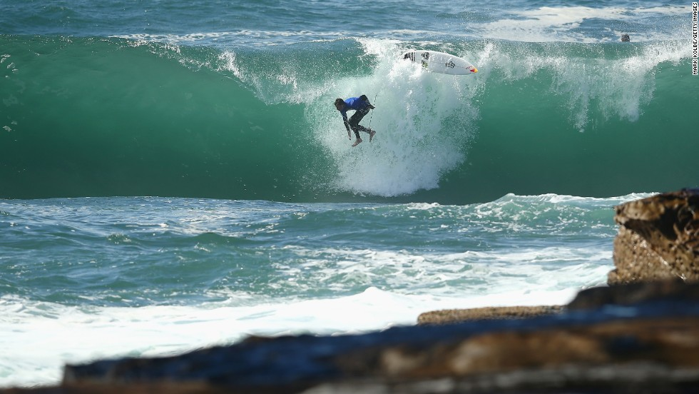 Ian Walsh wipes out Sunday, August 31, during the Red Bull Cape Fear surfing event at Sydney's Cape Solander.