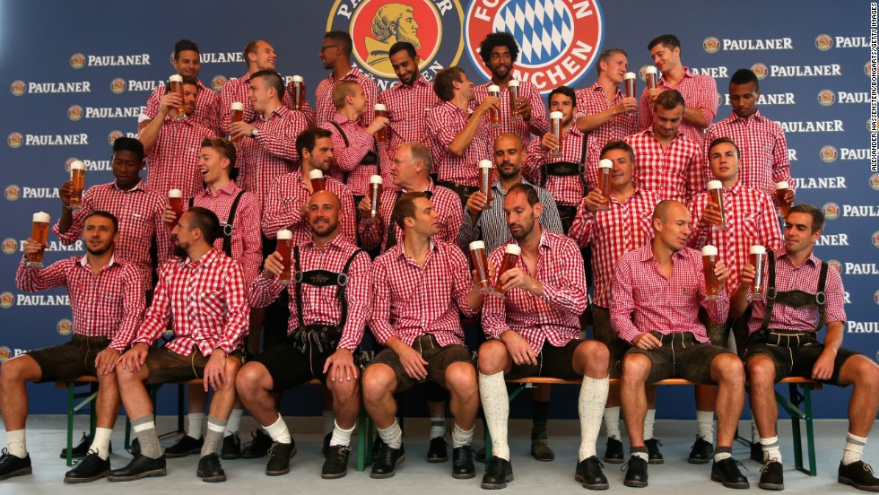 The Bayern Munich soccer team, wearing traditional Bavarian lederhosen, poses with Paulaner beers at a photo shoot Sunday, August 31, in Munich, Germany.