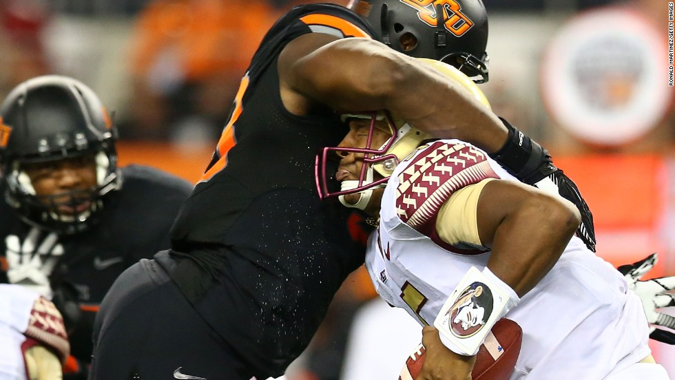 Oklahoma State's Emmanuel Ogbah sacks Florida State quarterback Jameis Winston during their season-opening game Saturday, August 30, in Arlington, Texas. But Winston, last season's Heisman Trophy winner, had the last laugh as the Seminoles won 37-31.