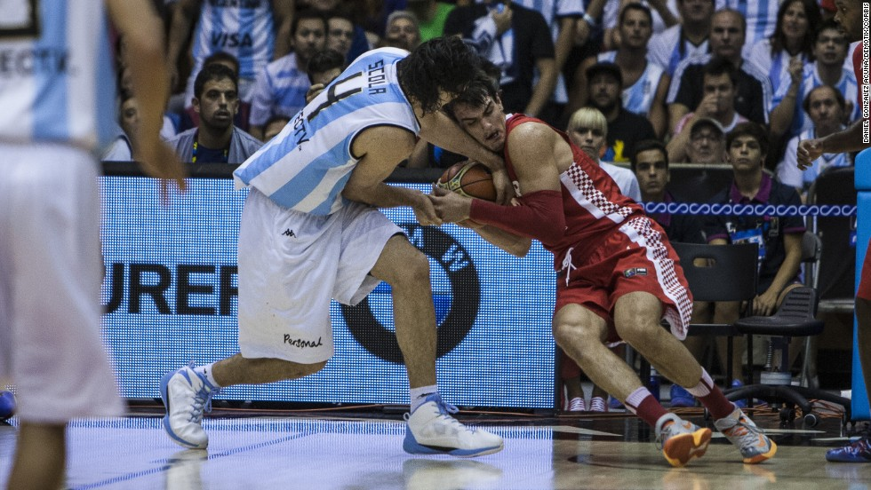 "Argentina's Luis Scola and Croatia's Dario Saric wrestle for the ball during a FIBA World Cup game Sunday, August 31, in Seville, Spain. <a href=""http://www.cnn.com/2014/08/25/worldsport/gallery/what-a-shot-0826/index.html"">See 40 amazing sports photos from last week</a>"
