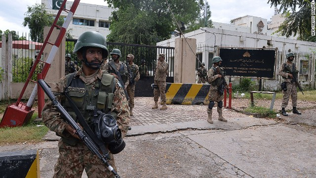 Soldiers stand guard outside the headquarters of state-owned Pakistani Television (PTV) on September 1.