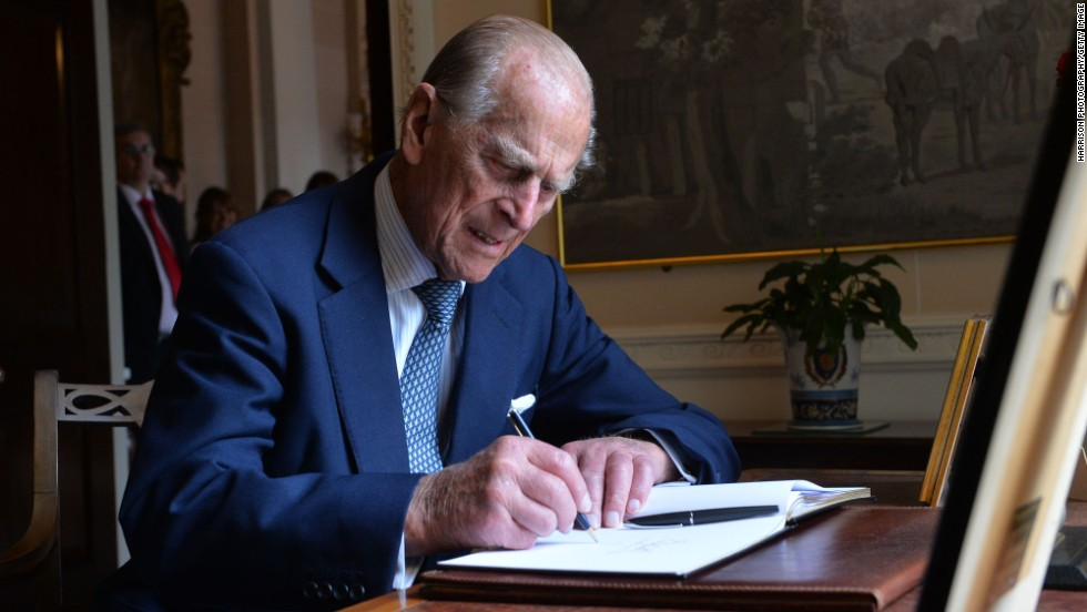 Prince Philip signs the guest book at Hillsborough Castle in Belfast, Northern Ireland, in June 2014.