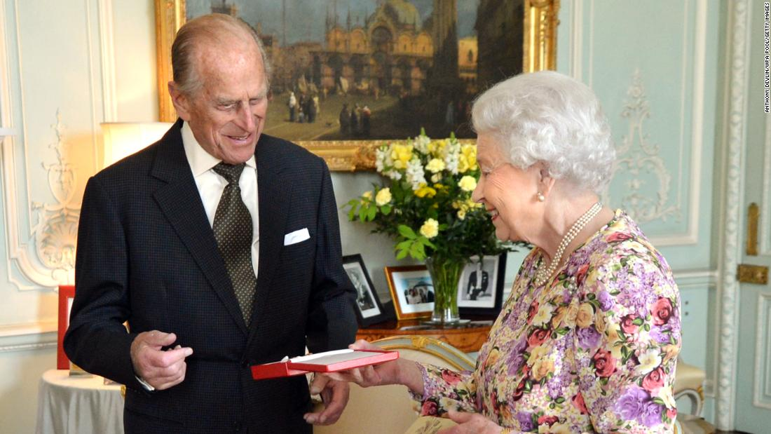The Queen presents Prince Philip with New Zealand's highest honor, the Order of New Zealand, at Buckingham Palace in June 2013.