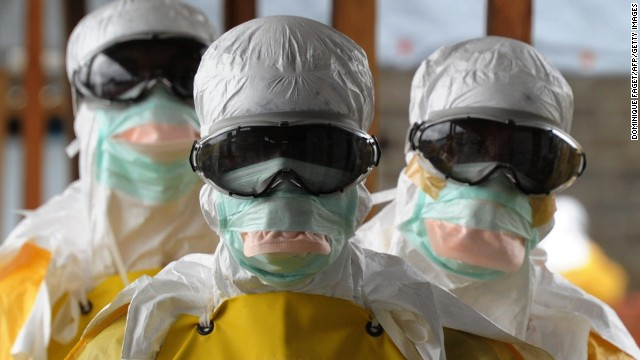 Caption:Health care workers, wearing protective suits, leave a high-risk area at the French NGO Medecins Sans Frontieres (Doctors without borders) Elwa hospital on August 30, 2014 in Monrovia. Liberia has been hardest-hit by the Ebola virus raging through west Africa, with 624 deaths and 1,082 cases since the start of the year. AFP PHOTO / DOMINIQUE FAGET (Photo credit should read DOMINIQUE FAGET/AFP/Getty Images)