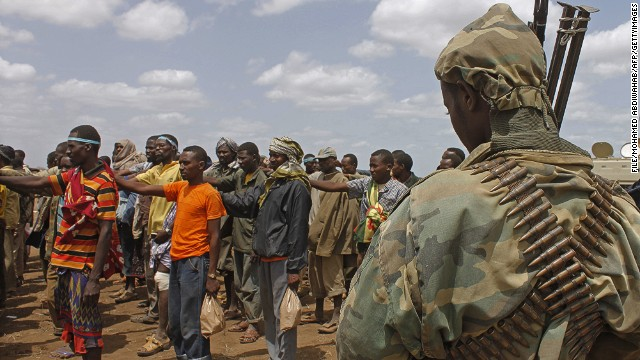 [File] Photo taken on September 22, 2012 shows members of the Al-Qaeda linked Al-Shabaab standing on after giving themselves up to forces of the African Union Mission in Somalia (AMISOM) in Garsale, some 10km from the town of Jowhar, 80km north of the capital Mogadishu.
