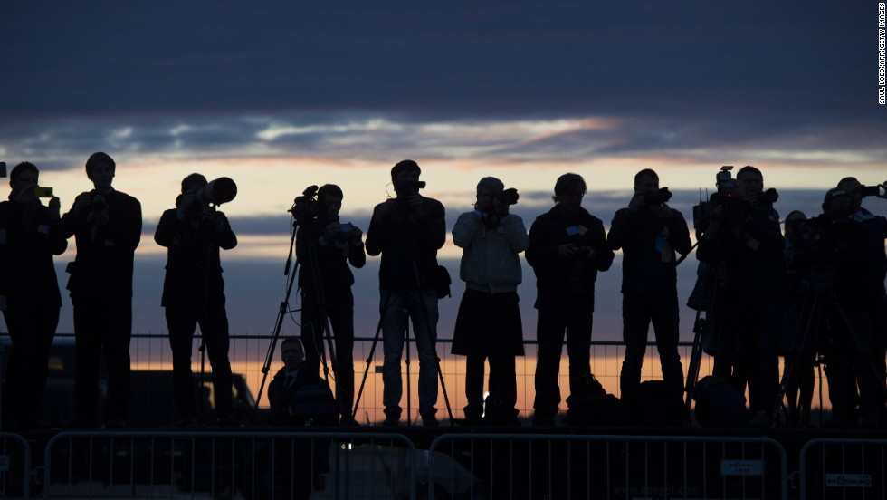 Estonian press photographers cover Obama's arrival at Tallinn Airport early on September 3.