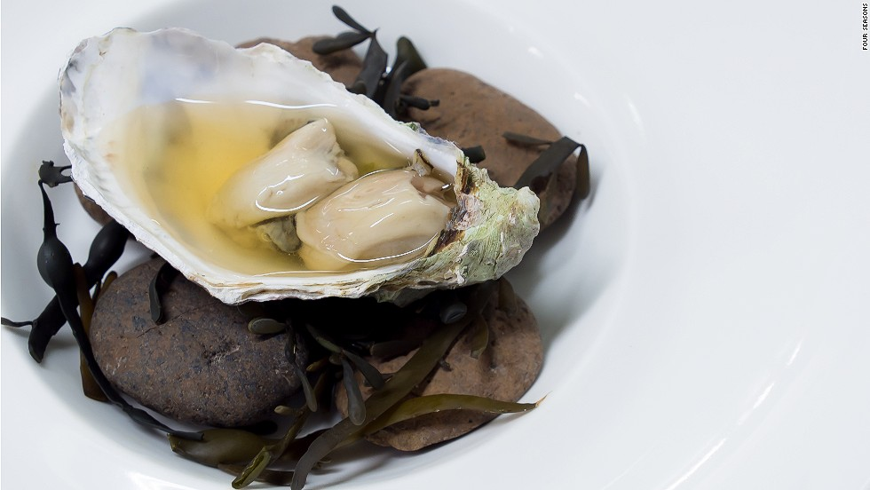 "<strong>The dish:</strong> Oyster in dashi, green lemon and ginger, by chef James Syhabout.  <br /><br />""This dish is inspired by the flavor of oysters when they've been pulled straight from the sea,"" says Syhabout, chef-owner of Michelin-starred Commis restaurant in Oakland, California. ""The oyster is placed on river stones and seaweed to reflect the oyster beds, and has an oceanic kelp broth and a classic oyster mignonette of shredded cucumber marinated in ginger and green lemon."""