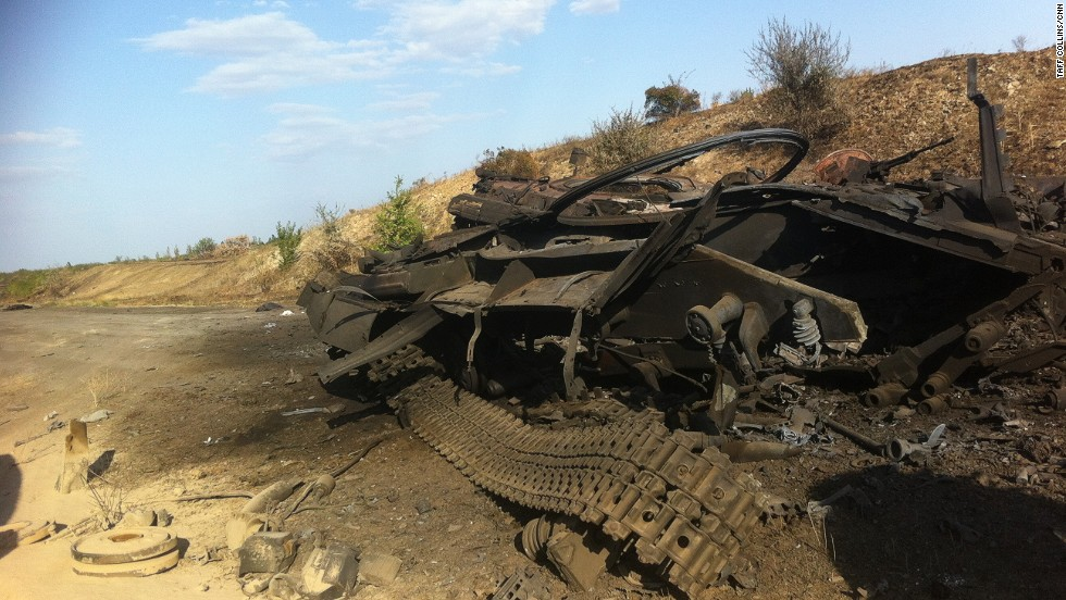 Burnt-out military vehicles litter the countryside in eastern Ukraine, including this example pictured on Tuesday September 2, 2014.
