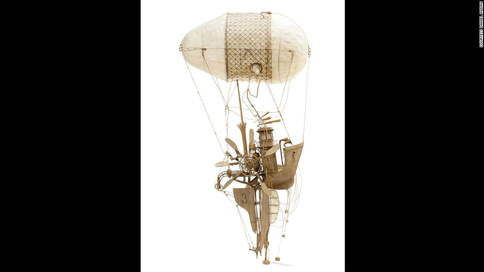 """The Captain"" is a whimsical flying machine crafted from three gauges of cardboard."
