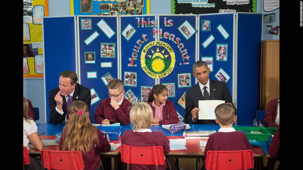 Obama and Cameron meet with schoolchildren in Newport on September 4 before attending the NATO summit.