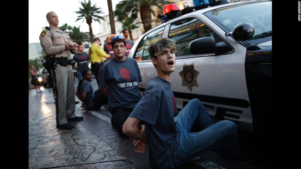 Handcuffed protesters chant for increased wages in Las Vegas on September 4.