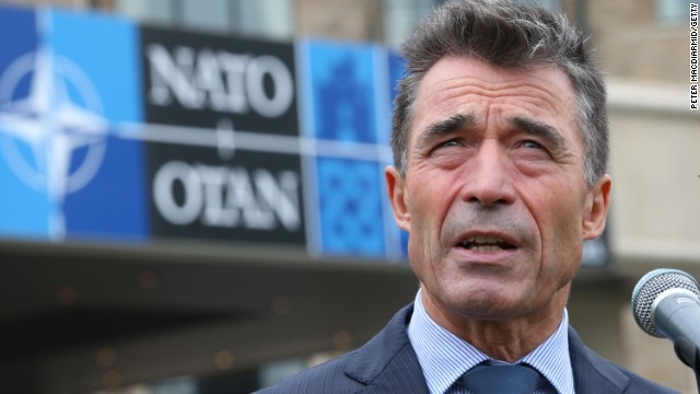 Caption:NEWPORT, WALES - SEPTEMBER 04: NATO Secretary General Anders Fogh Rasmussen talks to reporters at the NATO Summit on September 4, 2014 in Newport, Wales. Leaders and senior ministers from around 60 countries are gathering for the two day meeting where Ukraine and the ISIS hostages are likely to be discussed. (Photo by Peter Macdiarmid/Getty Images)