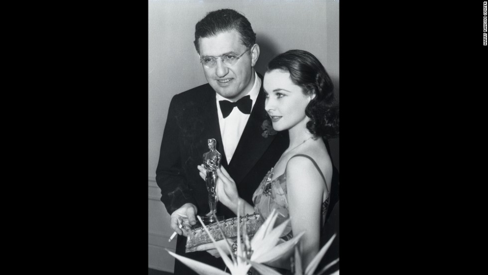 "Leigh celebrates winning the best actress Oscar with Selznick at the Academy Awards ceremony in 1940. ""Gone With the Wind"" also took home top honors for best picture and director, and the producer received the Irving G. Thalberg Memorial Award for career achievement. ""Selznick was the primary artistic influence on the film. He really pushed everyone,"" says Wilson, the exhibition curator. ""His hand touched everything."""