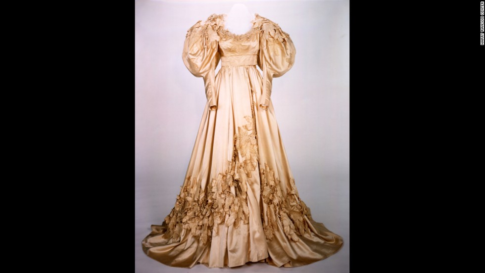 Scarlett's wedding gown is one of two replicas appearing in the exhibition. This dress and a blue velvet peignoir the character wears in her daughter's death scene were deemed too delicate and fragile for conservation efforts. In the film, the wedding dress appears bulky and ill-fitting on Scarlett, who has rushed into marriage with Charles Hamilton, borrowing her mother's gown.