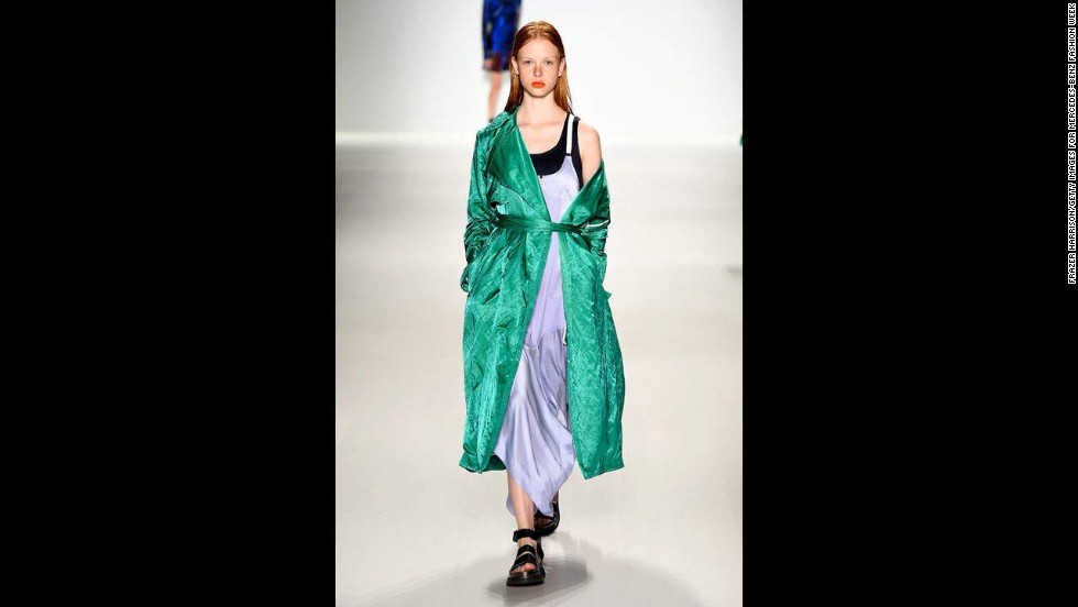A  model was styled with an off-shoulder silk robe coat at the Richard Chai show.