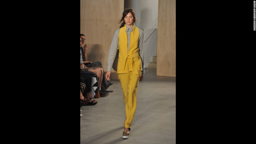 A model walked the runway in yellow suiting with a twist for Creatures of the Wind.