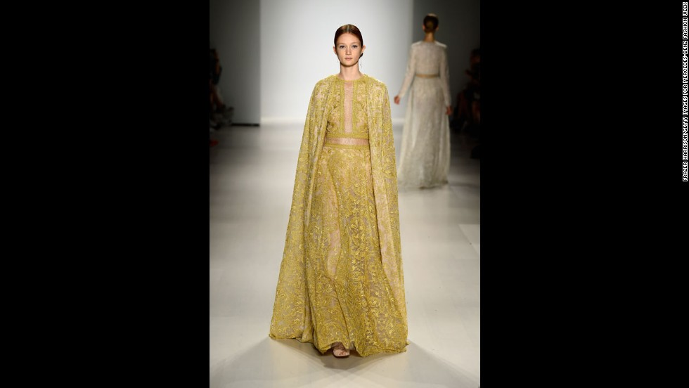Designer Tadashi Shoji played with caped gowns in his spring collection.