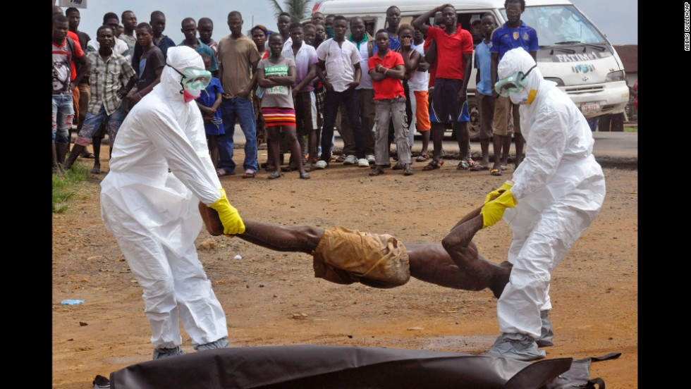 "Health workers place a corpse into a body bag Thursday, September 4, in Monrovia, Liberia. The suspected cause of death was the Ebola virus, which has killed more than 1,900 people in West Africa since December, according to the World Health Organization. Health officials say <a href=""http://www.cnn.com/2014/04/04/world/gallery/ebola-in-west-africa/index.html"">the current Ebola outbreak</a> is the deadliest ever."