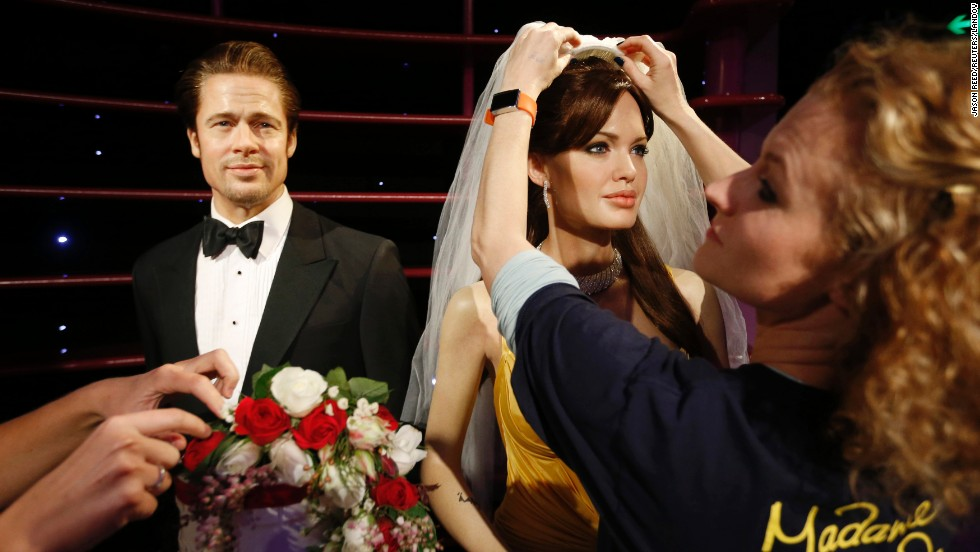 "A wax model of actress Angelina Jolie is fitted with a bridal veil Friday, August 29, by a staff member of Madame Tussauds in Sydney. Jolie and actor Brad Pitt <a href=""http://www.cnn.com/2014/08/28/showbiz/celebrity-news-gossip/brad-pitt-angelina-jolie-married/index.html"">married last month</a> in France."