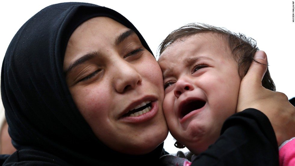 Ragheda, the wife of Lebanese soldier Ali Sayid, holds their 10-month-old daughter, Rahaf, during his funeral in Fnaydek, Lebanon, on Wednesday, September 3. Sayid was beheaded by Islamic militants who overran the Lebanese town of Arsal for several days last month. Arsal is near the Syrian border.