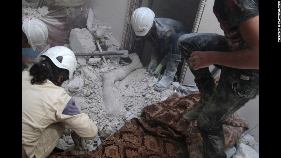 "Residents of Aleppo, Syria, remove a body from debris on Friday, August 29, after what activists claim was shelling by forces loyal to Syrian President Bashar al-Assad. The United Nations estimates more than 190,000 people have been killed in Syria since an uprising in March 2011 <a href=""http://www.cnn.com/2014/02/10/middleeast/gallery/syria-unrest-2014/index.html"">spiraled into civil war.</a>"