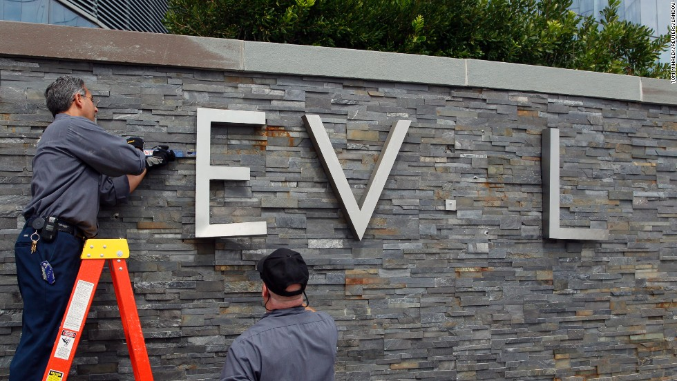 Employees of the Revel Casino Hotel remove signage from its wall along the boardwalk in Atlantic City, New Jersey, on Monday, September 1. Revel closed the next day after its second bankruptcy since opening in 2012.