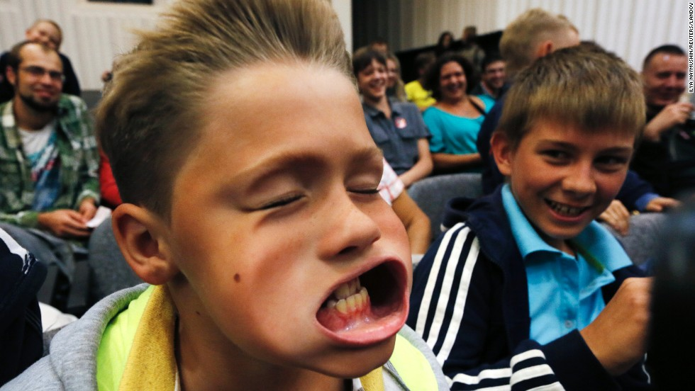 A boy experiences the effect of air pressure Friday, August 29, at the Newton Park interactive science museum in Krasnoyarsk, Russia.