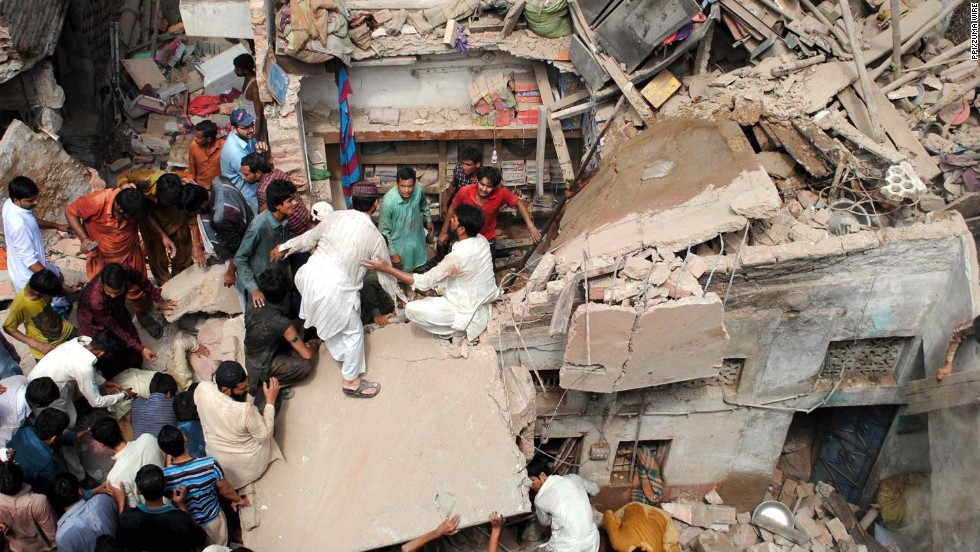 Rescuers work at the site of a residential building collapse in Hyderabad, Pakistan, on Tuesday, September 2.