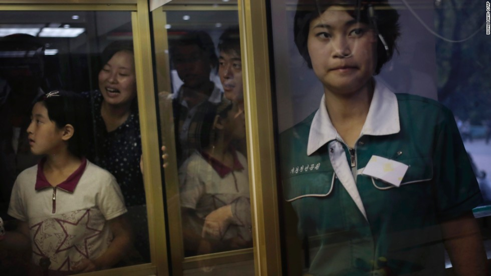 People watch others play an arcade game Wednesday, September 3, at the Kaeson Youth Amusement Park in Pyongyang, North Korea.