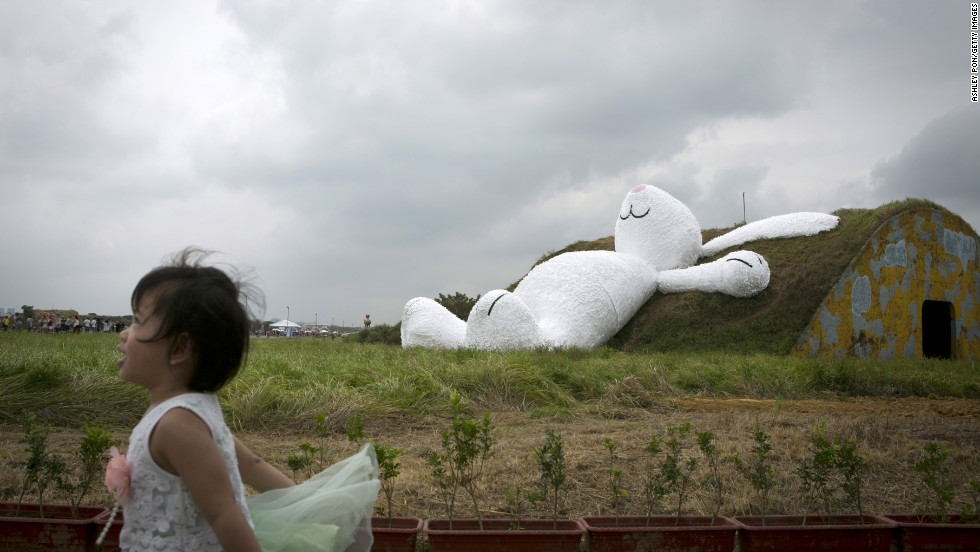 An 82-foot white rabbit, created by Dutch artist Florentijn Hofman, sits in Taipei, Taiwan, on Thursday, September 4. The rabbit is part of the Taoyuan Land Art Festival at Taoyuan Naval Base.