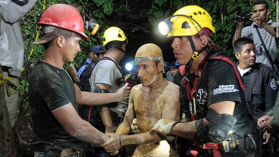 "A man is covered in mud Friday, August 29, after he was rescued from <a href=""http://www.cnn.com/2014/08/30/world/americas/nicaragua-trapped-miners/index.html"">a collapsed mine</a> near Bonanza, Nicaragua."