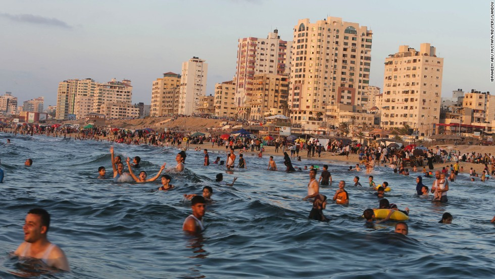 "People swim in the Mediterranean Sea off the coast of Gaza City, Gaza, on Friday, August 29, days after a ceasefire ended <a href=""http://www.cnn.com/2014/07/18/world/gallery/israel-gaza/index.html"">more than seven weeks of fighting</a> between Israel and Hamas. <a href=""http://www.cnn.com/2014/08/29/world/gallery/week-in-photos-0829/index.html"">See last week in 36 photos</a>"