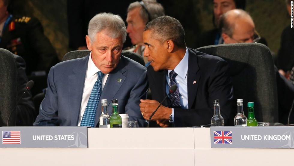 Obama speaks with Defense Secretary Chuck Hagel at a meeting on the future of NATO on September 5.