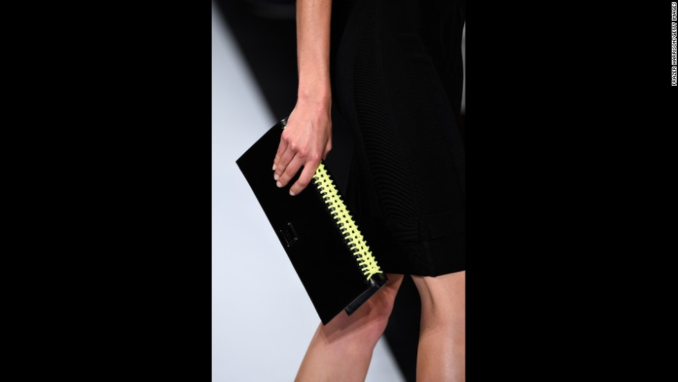 A model walked the runway with a geometric clutch at Hervé Léger.