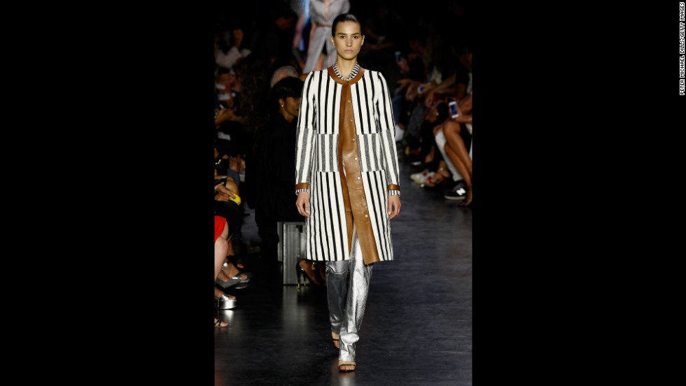 A model walked the Altuzarra fashion show in a black and white striped jacket with leather trim.