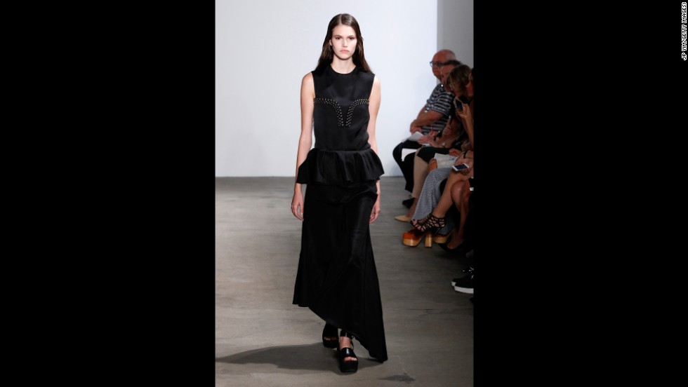 For Derek Lam's final look, a model walked in an asymmetrical black skirt with a peplum waist.