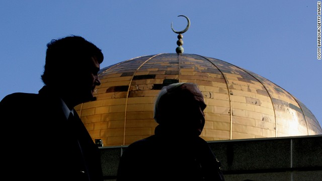 People leave Regent's Park Mosque after prayers were held ahead of a private funeral for the poisoned former Russian KGB spy Alexander Litvinenko on December 7, 2006 in London, England.