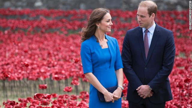Catherine, Duchess of Cambridge and Prince William, Duke of Cambridge walk through an installation entitled 'Blood Swept Lands and Seas of Red' by artist Paul Cummins, made up of 888,246 ceramic poppies in the moat of the Tower of London, to commemorate the First World War on August 5, 2014 in London, England.