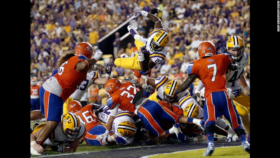 LSU running back Kenny Hilliard leaps into the end zone for a two-point conversion Saturday, September 6, during a home game against Sam Houston State. The Tigers blanked the visiting Bearkats 56-0 in Baton Rouge, Louisiana.