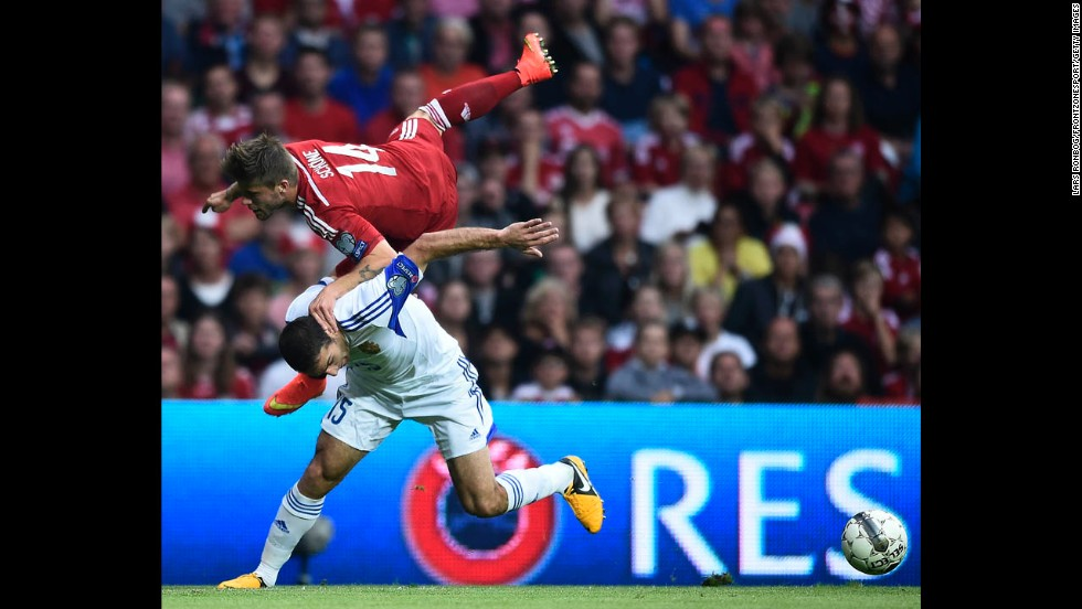 Lasse Schone of Denmark flies over Hrayr Mkoyan of Armenia as they compete for the ball Sunday, September 7, during a qualifying match for the 2016 European Championship. Denmark won 2-1 in the match, which was played in Copenhagen, Denmark, and opened both teams' qualifying campaigns.