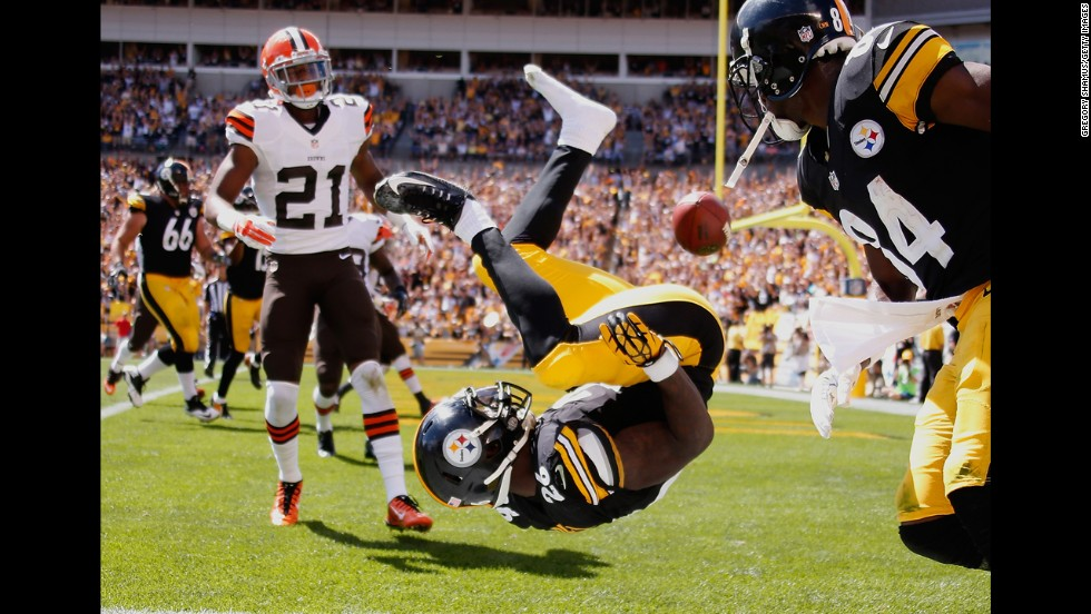 Pittsburgh Steelers running back Le'Veon Bell celebrates after he scored a touchdown against the Cleveland Browns on Sunday, September 7, in Pittsburgh. The Steelers fought off a fierce comeback by the Browns to win 30-27 in the opening week of the NFL season.