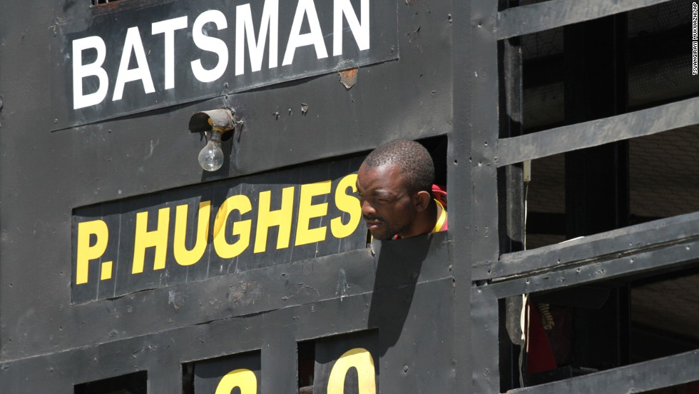 A scoreboard operator in Harare, Zimbabwe, watches the One Day International cricket match between South Africa and Australia on Tuesday, September 2. Australia won the match by 62 runs.