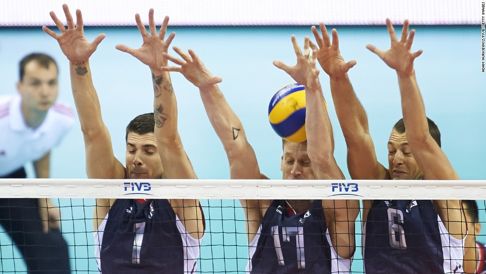From left, American volleyball players Matthew Anderson, Maxwell Holt and Paul Lotman defend at the net during a FIVB World Championship match against Puerto Rico on Thursday, September 4. The United States won the match in straight sets.