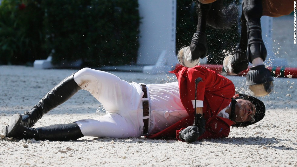 Chilean rider Tomas Couve Correa lies on the ground after falling off his horse, Fardon, during the World Equestrian Games in Caen, France, on Wednesday, September 3. He was stretchered off the course and taken to the hospital for overnight evaluation.