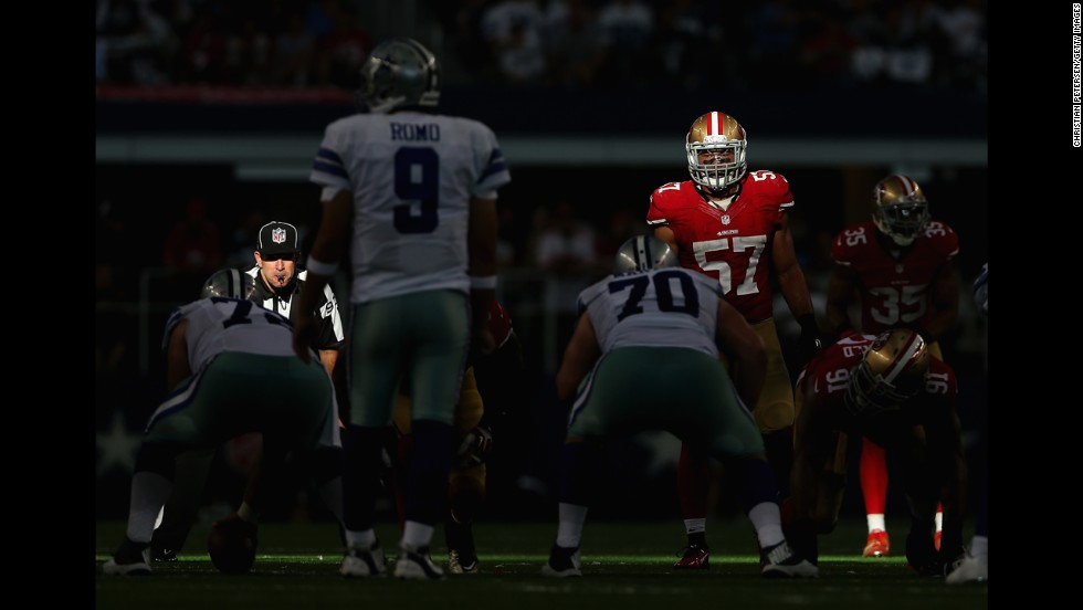 Sunlight falls on San Francisco linebacker Michael Wilhoite before a snap Sunday, September 7, in Arlington, Texas. The 49ers defeated the Dallas Cowboys 28-17 in their first game of the NFL season.