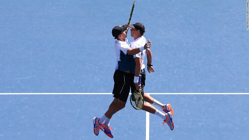 Twin brothers Bob Bryan and Mike Bryan bump chests Wednesday, September 3, after defeating Scott Lipsky and Rajeev Ram in a U.S. Open semifinal. The Bryans went on to win the final for their fifth U.S. Open title together.