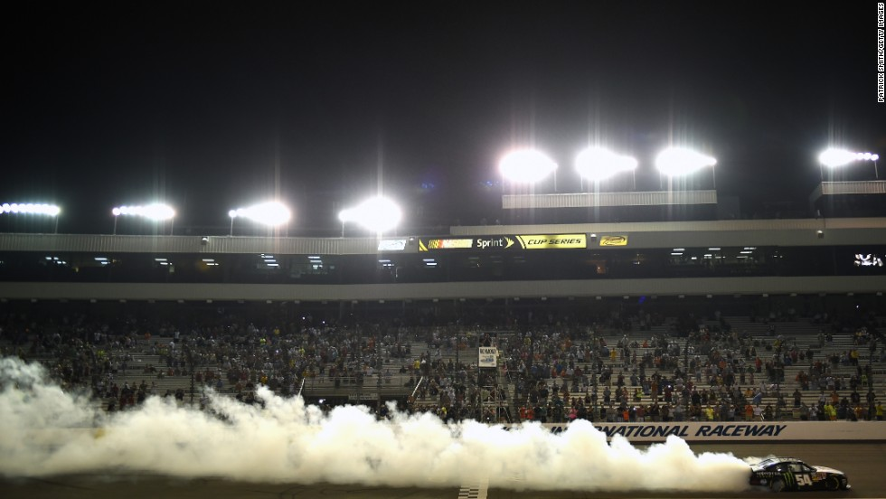 NASCAR driver Kyle Busch celebrates with a burnout after winning the Nationwide Series race in Richmond, Virginia, on Friday, September 5.