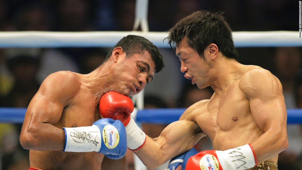 "WBC flyweight champion Akira Yaegashi, right, punches Roman Gonzalez during their title bout Friday, September 5, in Tokyo. Gonzalez, a Nicaraguan fighter nicknamed ""El Chocolatito,"" won by a ninth-round technical knockout to become the new champion and improve his professional record to 40-0."