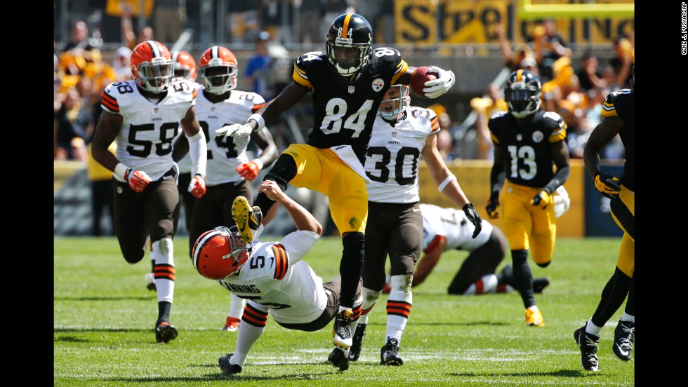 Pittsburgh Steelers punt returner Antonio Brown kicks Cleveland Browns punter Spencer Lanning while returning a punt in the second quarter of an NFL game Sunday, September 7, in Pittsburgh. Brown, who said he was trying to leap over Lanning on the play, received a 15-yard penalty for unnecessary roughness.
